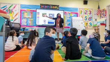 Preschool kids in masks in an ESL classroom