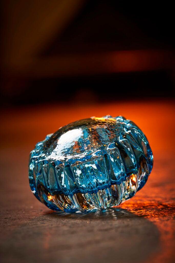 a gem-like chunk of ribbed blue glass