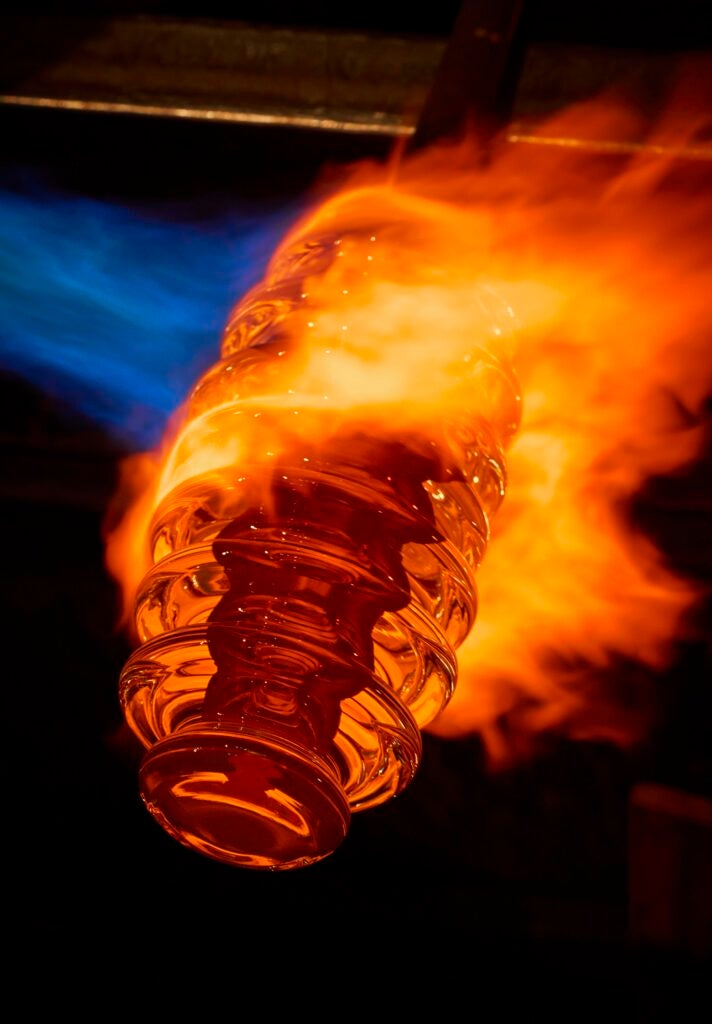 a flaming honeycomb-shaped piece of molten glass