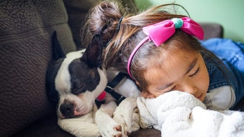 Kid and puppy taking a nap on the couch as part of a healthy sleep schedule