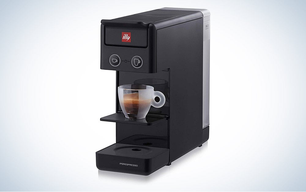 Illy Y3.3 Espresso and Coffee Machine with small see-through glass of coffee