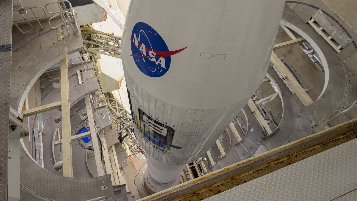A top-looking-down photo of a rocket with the blue NASA logo.