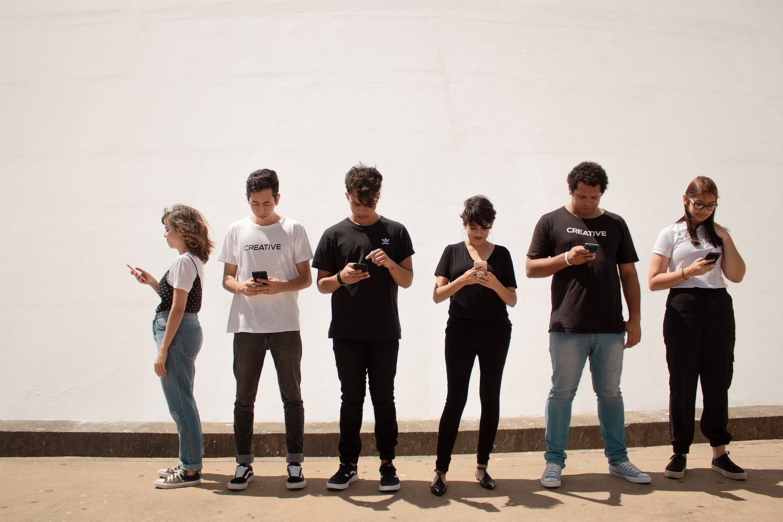 teens texting on smartphone