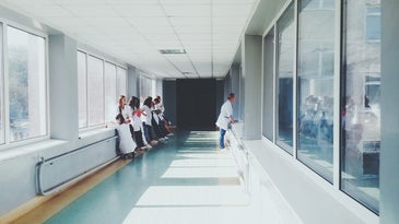 people standing in medical center hallway