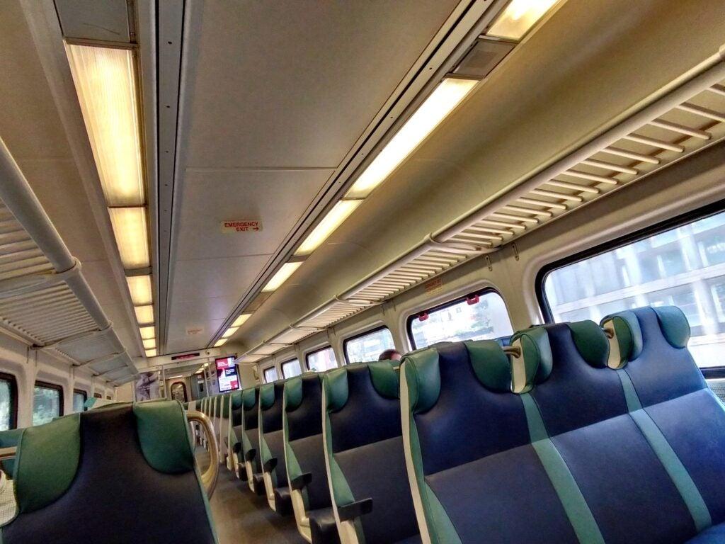 A car of empty seats inside a commuter train.