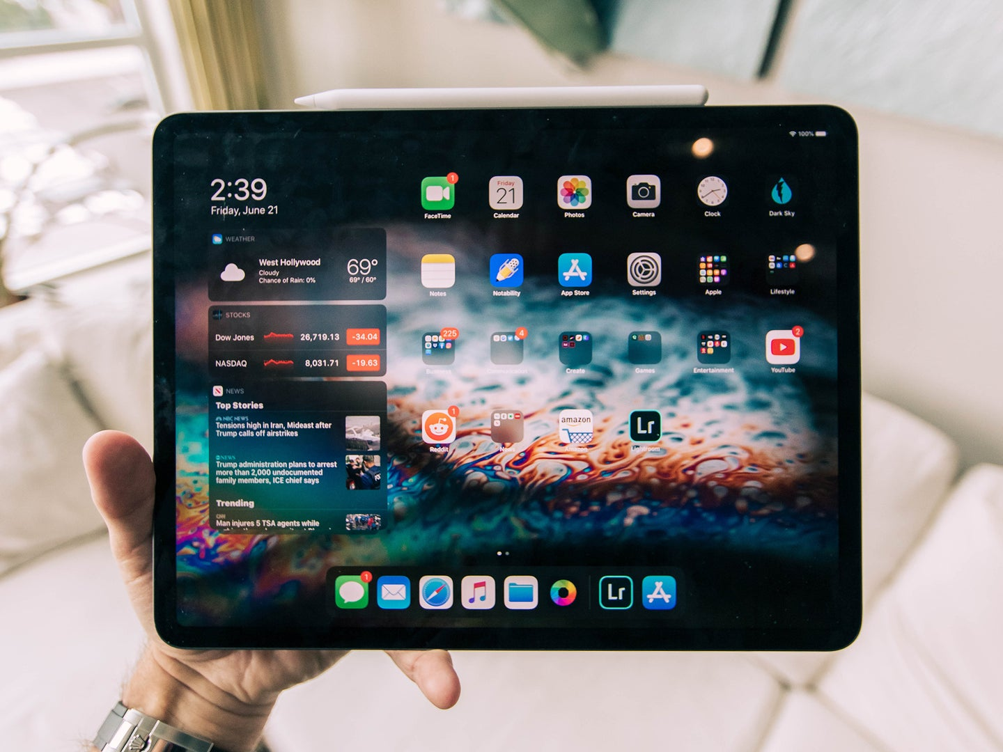 Hand holding an iPad pro with iPadOS 15