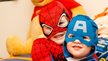 A child dressed as Spider-Man and a child dressed as Captain America