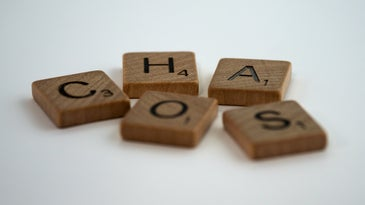 Chaos spelled in Scrabble pieces