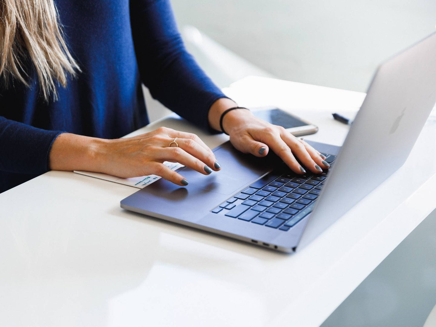 Person working on a laptop computer
