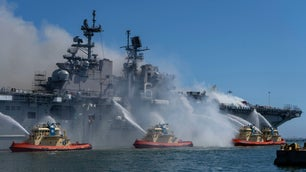 USS Bonhomme Richard submarine fire being extinguished by multiple Navy boats