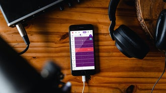 Mobile recording rig with an iphone, interface, headphones, and microphones
