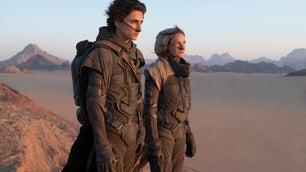 Dune 2021 movie actors looking across the desert of Arrakis